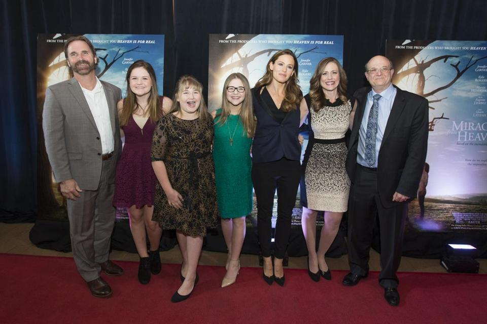 "From left): Kevin, Abbie, Adelynn, and Annabel Beam, Jennifer Garner, Christy Beam, and Dr. Samuel Nurko on the red carpet at the opening night of ""Miracles From Heaven"" in Chestnut Hill earlier this month."